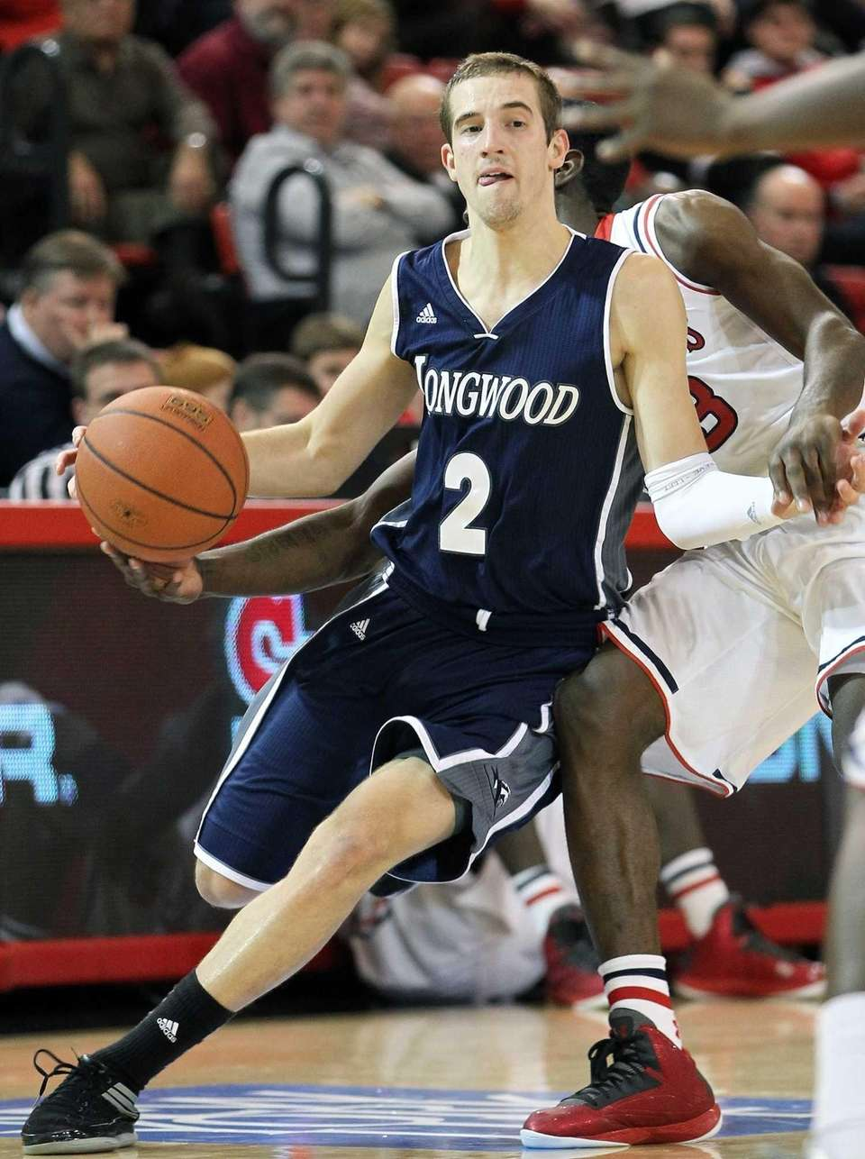 Longwood point guard Lucas Woodhouse dribbles the ball