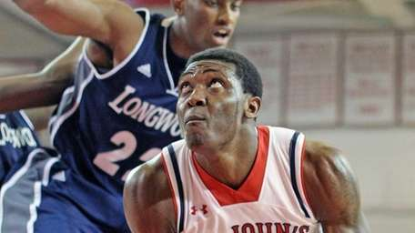 St. John's Chris Obekpa (12) is covered by