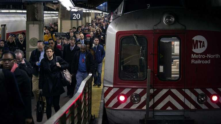 People disembark from a Metro North train at