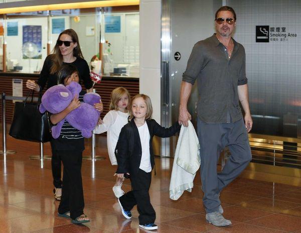 Actress Angelina Jolie and actor Brad Pitt arrive