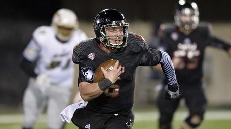 Northern Illinois quarterback Jordan Lynch runs for a