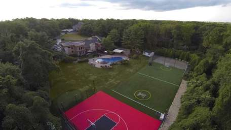 The backyard of this two-acre property, listed in