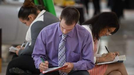 Job seekers fill out applications this past month