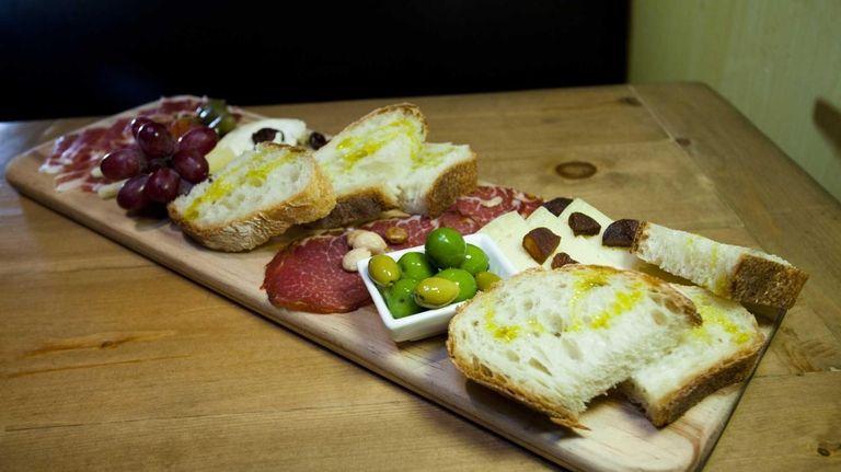 A selection of meats and cheeses at Plancha