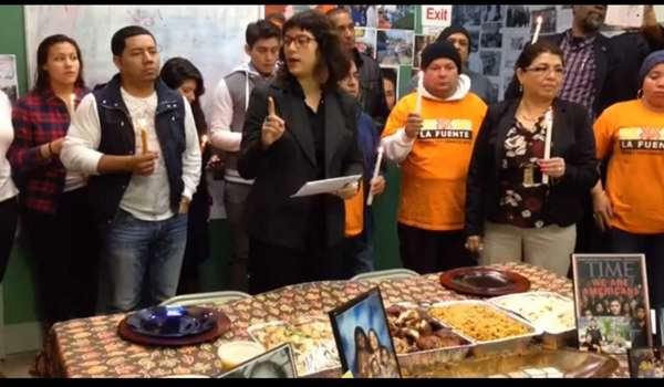 Community organizer Karina Claudio-Betancourt, center, leads a Thanksgiving