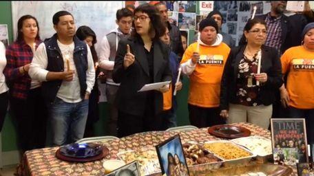 Community organizer Karina Claudio-Betancourt, center, leads a Thanksgiving
