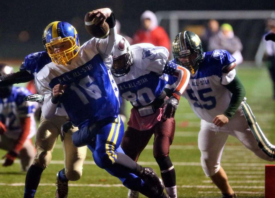 Comsewogue quarterback Andy Steck (no. 16) scores a