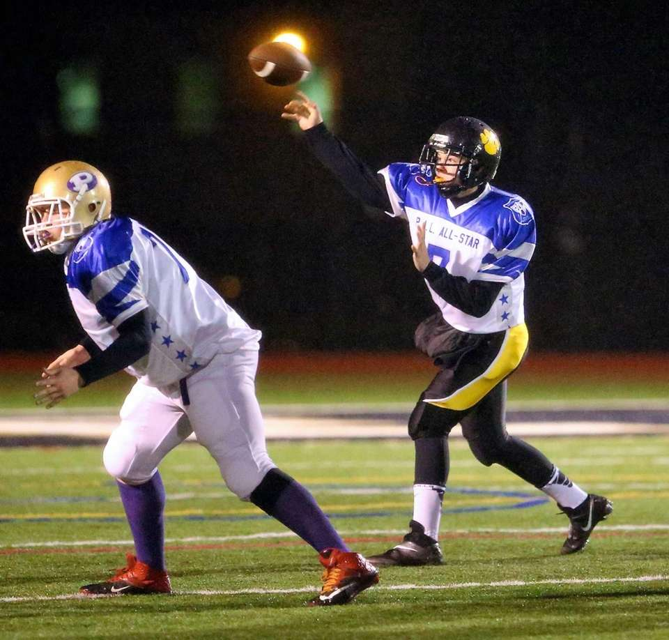 Commack quarterback Rob Paccione (no. 8) attempts a