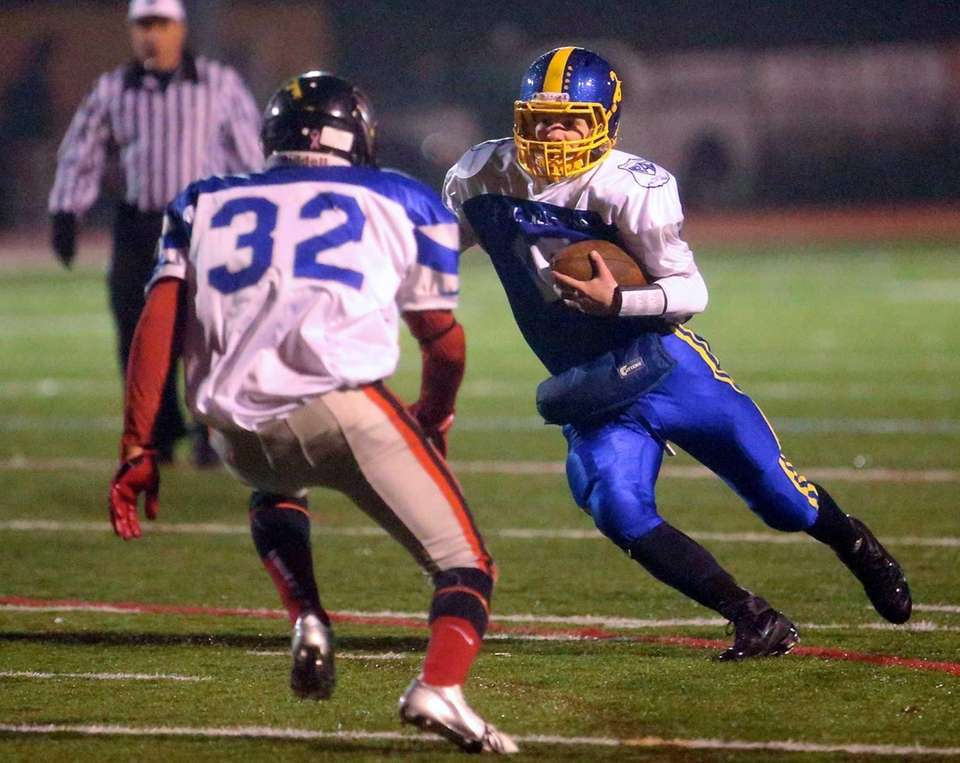 Comsewogue quarterback Andy Steck (no.16) takes the keeper