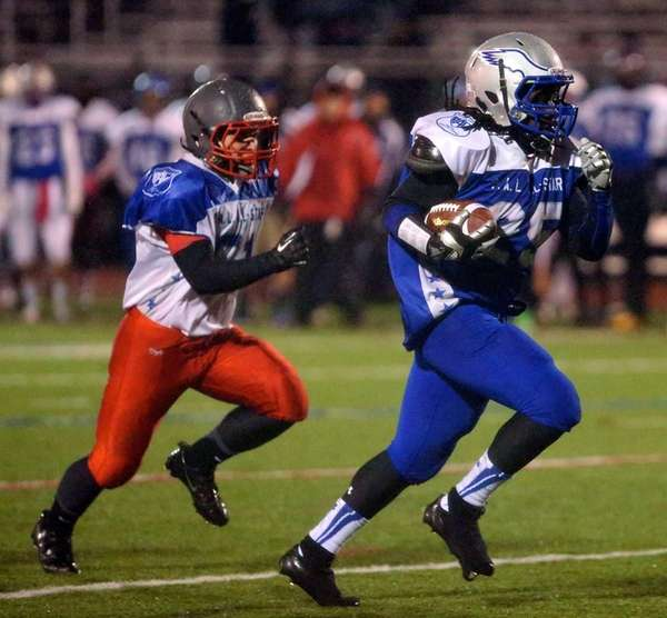 Copague running back Willie McFadden (no. 25) rushes