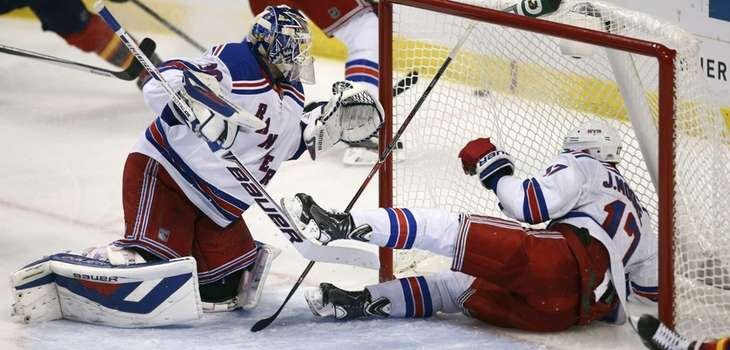 Rangers defenseman John Moore (17) slides past goalie