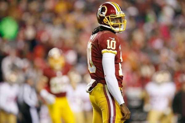 Washington Redskins quarterback Robert Griffin III looks back