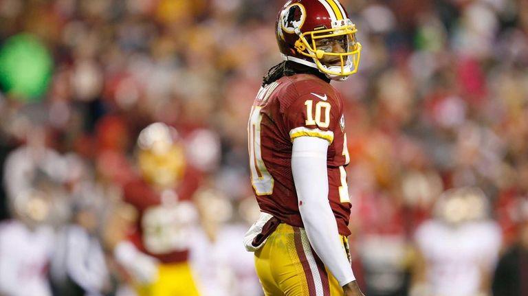 Washington Redskins quarterback Robert Griffin III looks back