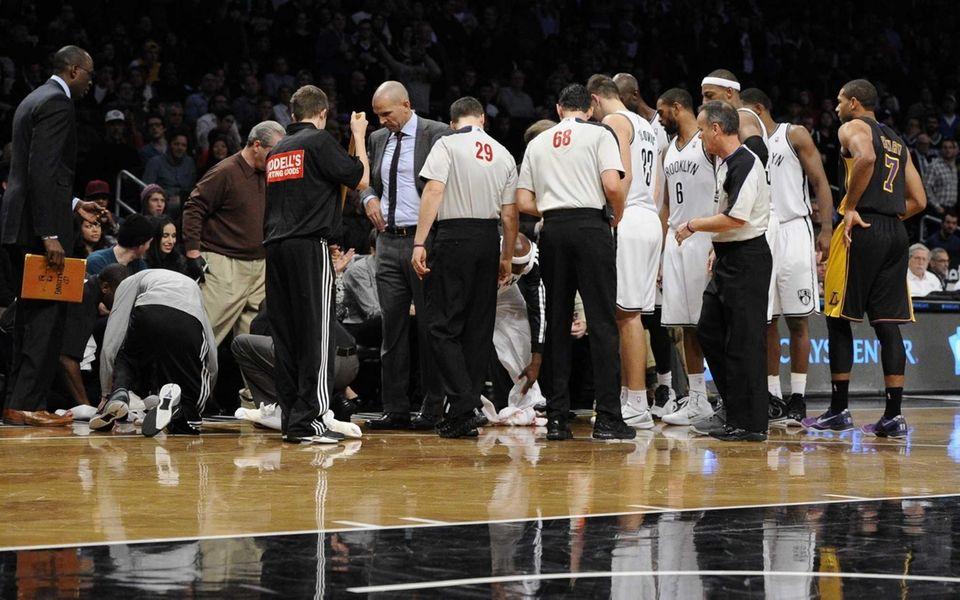 Nets court attendants clean up head coach Jason