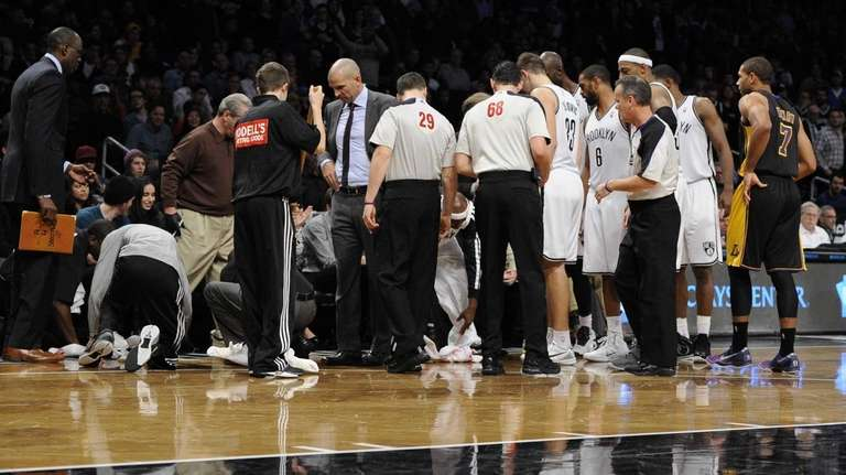 Nets court attendants clean up head coach Jason