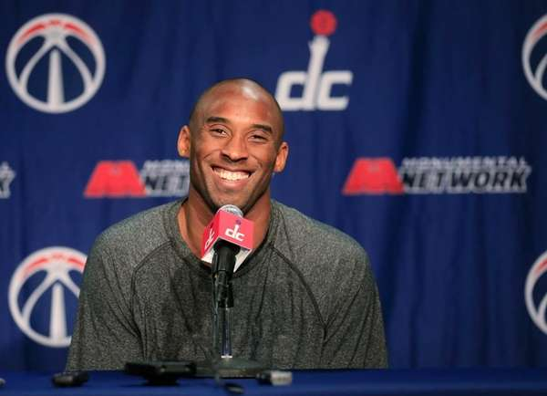 Los Angeles Lakers guard Kobe Bryant talks with