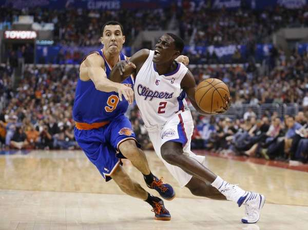 Los Angeles Clippers guard Darren Collison (right) drives
