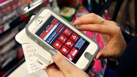Tashalee Rodriguez, of Boston, uses a smart phone
