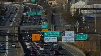 A traffic camera image shows traffic backed up