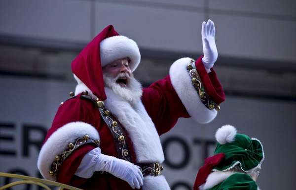 Santa Claus waves during the Macy's Thanksgiving Day