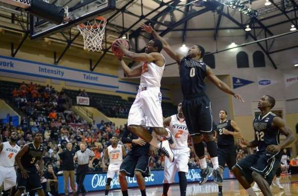 Oklahoma State's Markel Brown (22) goes up for