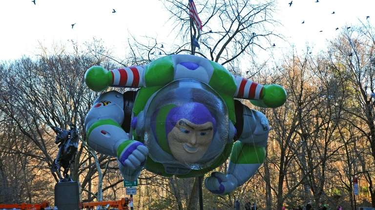 The Buzz Lightyear balloon floats down Sixth Avenue