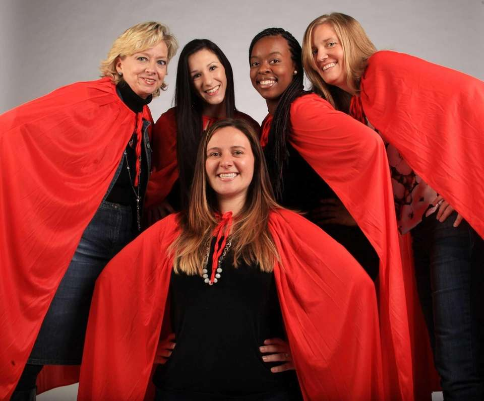 With their red capes on, ExploreLI's Super Shoppers