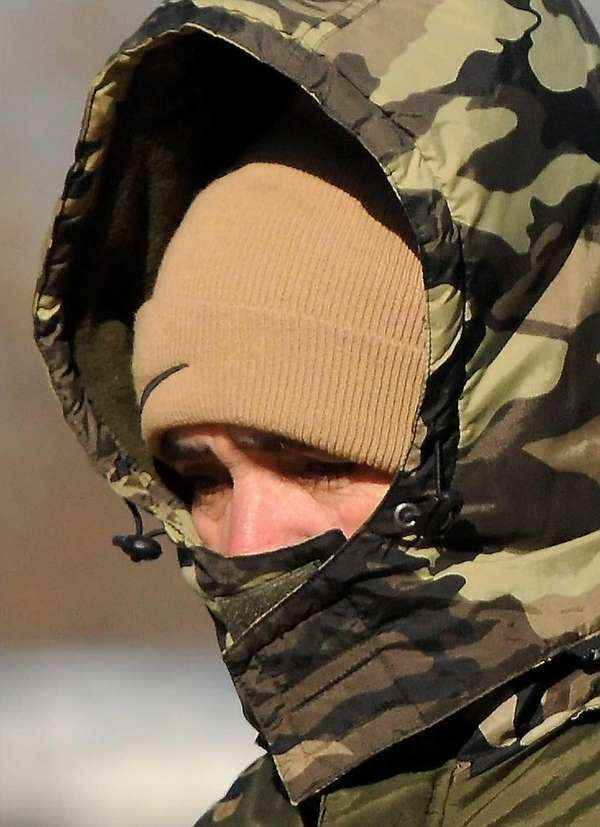 An unidentified man is seen bundled up as