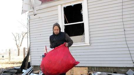 Jorge Garcia, 29, recovers belongings at a burned