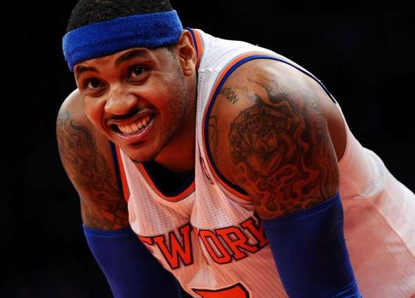 Carmelo Anthony of the Knicks looks on during