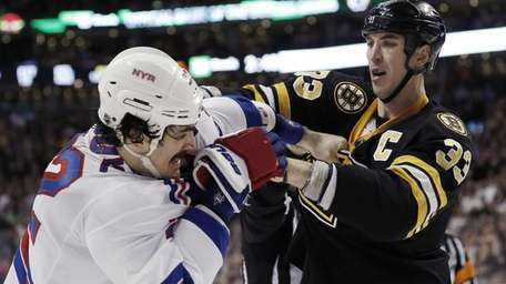 Boston's Zdeno Chara fights with Brian Boyle during