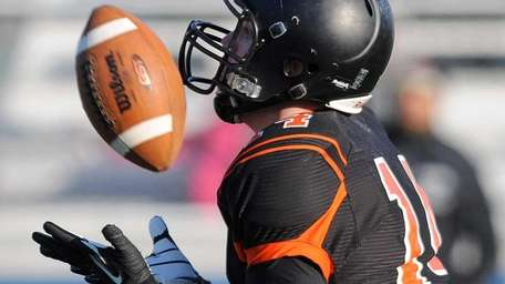 Babylon wide receiver Jake Carlock prepares to return