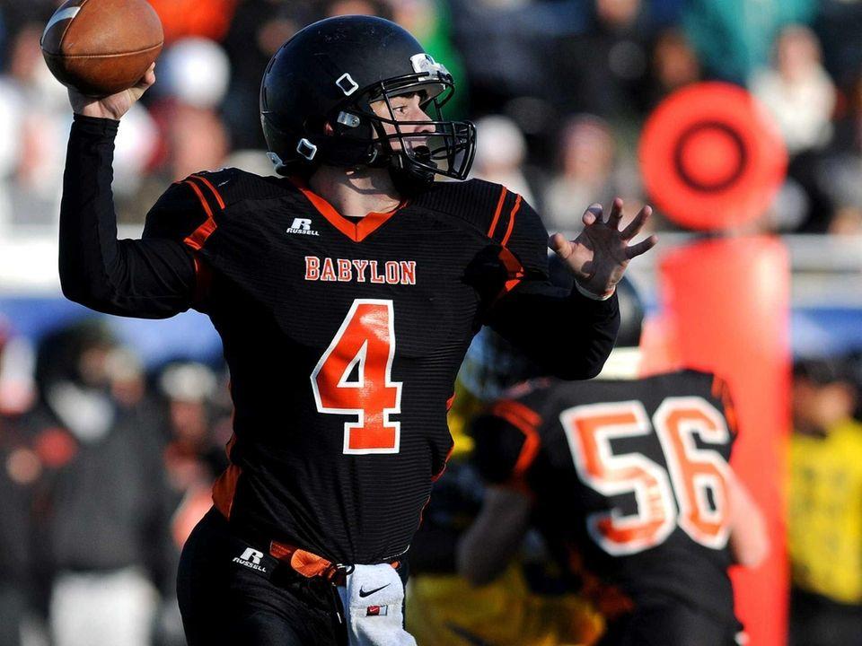Babylon quarterback Nick Santorelli throws a pass during