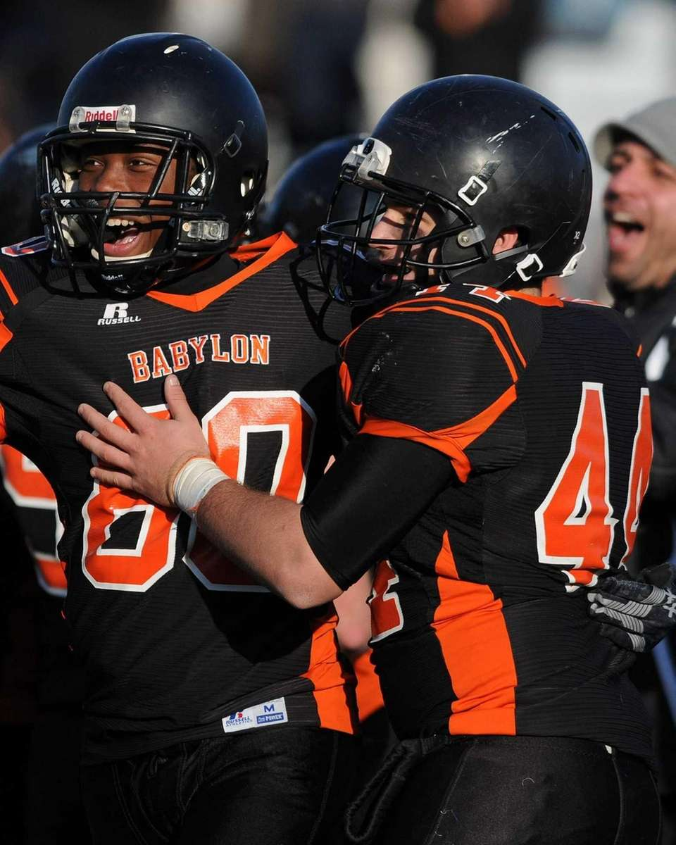 Babylon's Juawun Porter, left, and Shawn Tripp celebrate