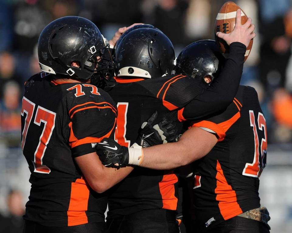 Babylon teammates celebrate after their 27-26 win over