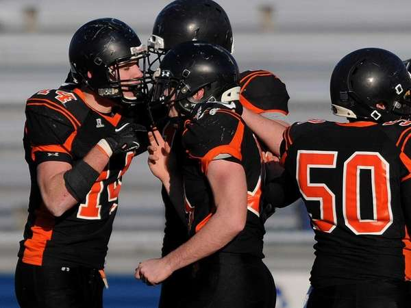 Babylon's Jake Carlock, left, gets congratulated by teammates