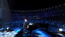 Billy Joel on stage at Shea Stadium. A