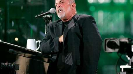 Billy Joel performs at Shea Stadium in Queens.
