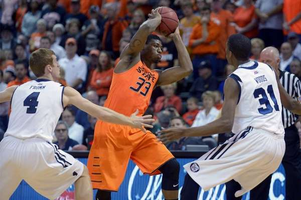 Oklahoma State guard Marcus Smart (33) passes the