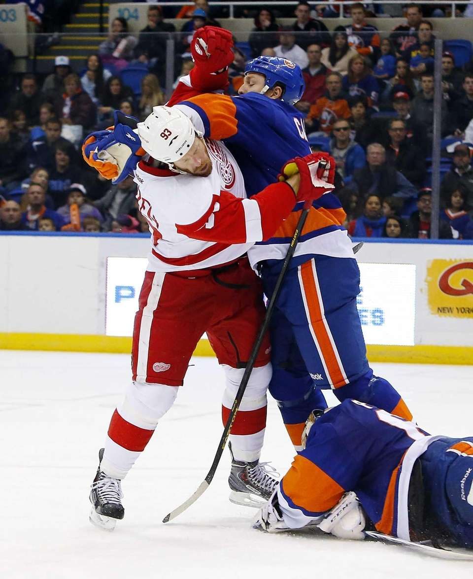 Islanders defenseman Matt Carkner (no. 7) fights during