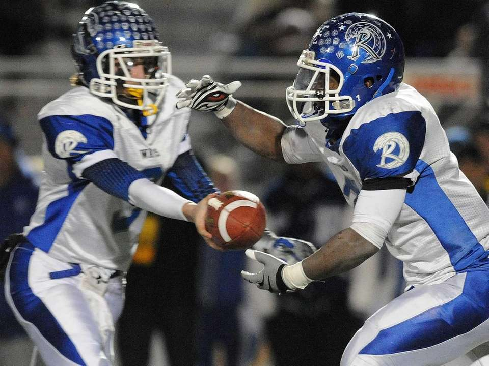 Riverhead's Ryun Moore (right) takes a handoff from