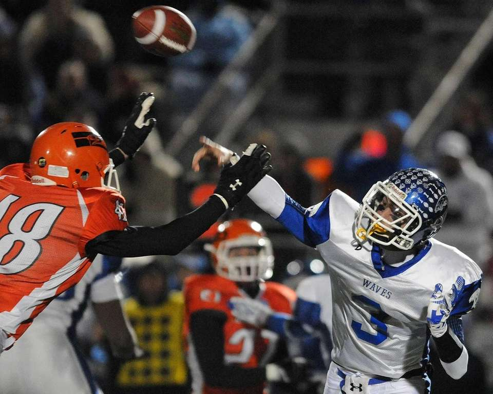 Riverhead quarterback Cody Smith (no. 3) throws a