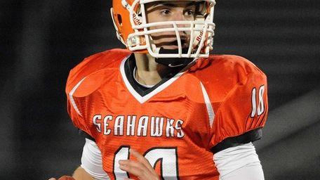 Carey quarterback Ray Catapano looks to pass against