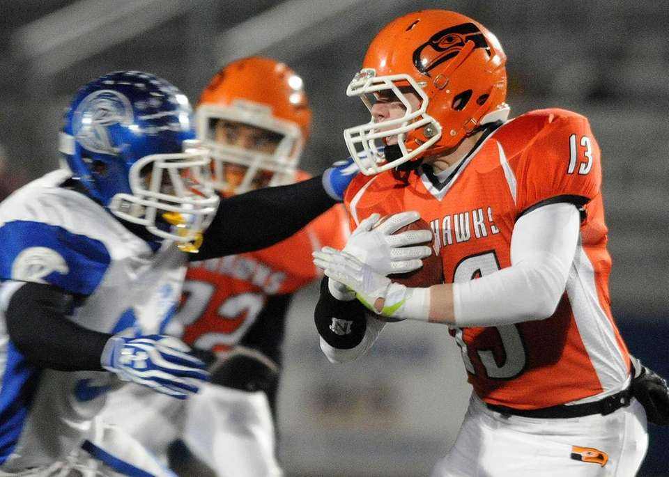 Carey's Nick Spillane (no. 13) fights for yards