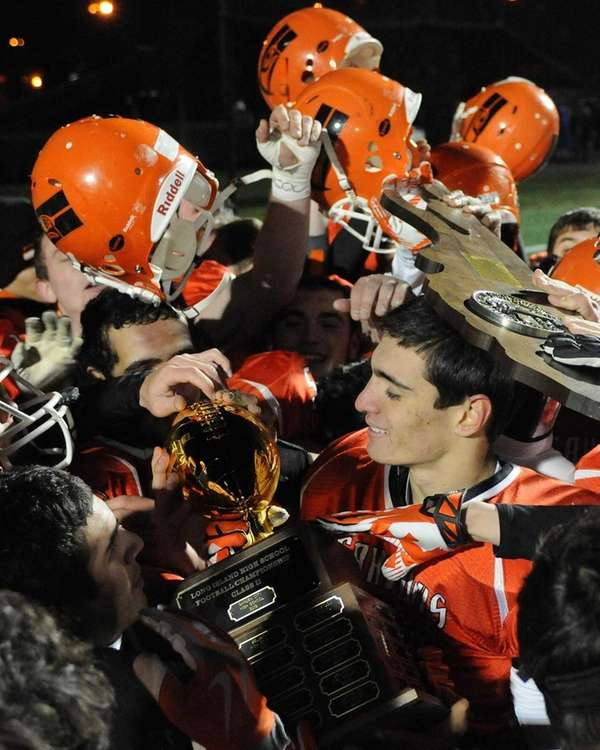 Carey quarterback Ray Catapano holds the championship trophy