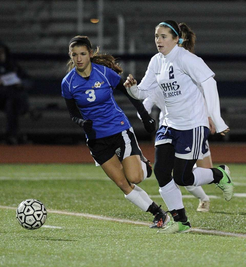 Nassau County's Alyssa Gangi (right) chases the ball