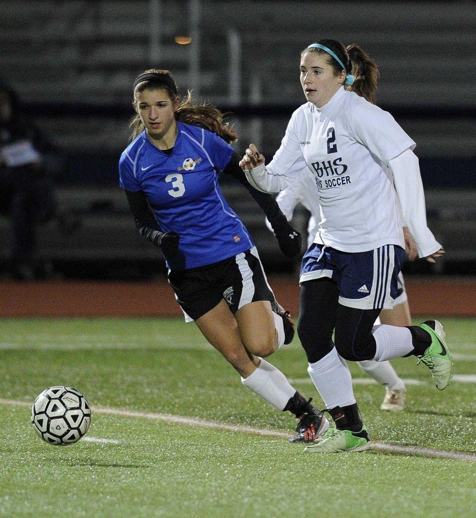 Nassau County's Alyssa Gangi (right) chases the ball