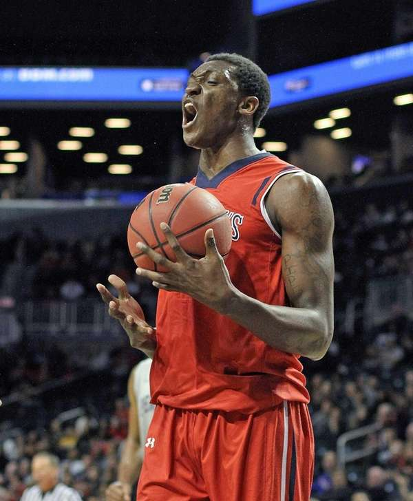 St. John's center Chris Obekpa reacts during a