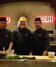 Sushi chefs Shigeki Uchiyama, left, and Hiroki Tanii