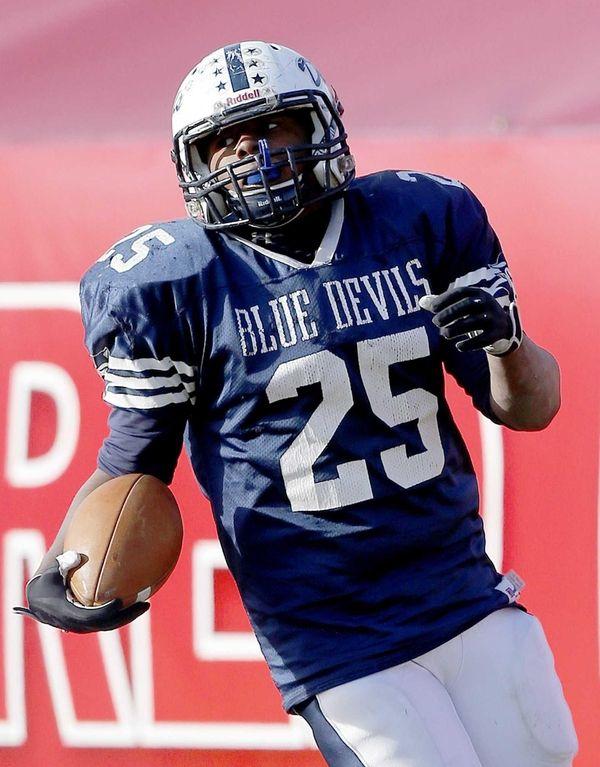 Huntington's Levar Butts runs in a touchdown during